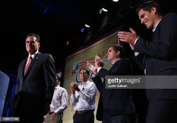 Republican presidential candidate former Massachusetts Gov Mitt Romney speaks as his sons Matt Romney Craig Romney Tagg Romney and Josh Romney...