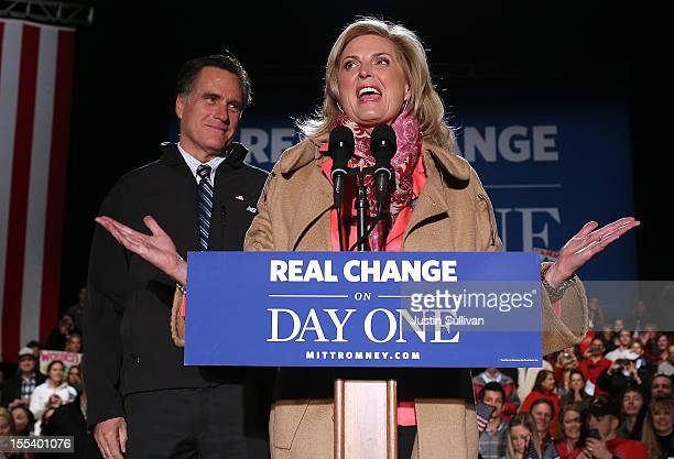 Republican presidential candidate former Massachusetts Gov Mitt Romney listens as his wife Ann Romney speaks during a campaign rally at Comfort...
