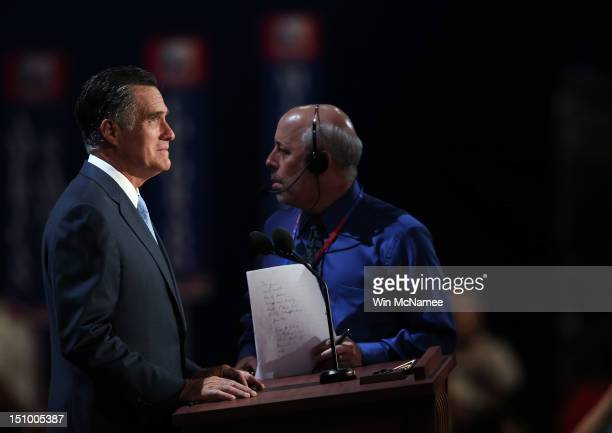 Republican presidential candidate former Massachusetts Gov Mitt Romney stands at the podium for a soundcheck with stage manager Howard Kolins during...