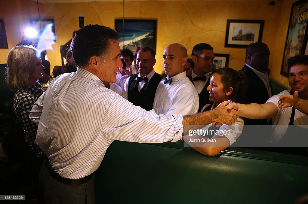 Republican presidential candidate, former Massachusetts Gov. Mitt Romney greets workers at Capedevila's at La Teresita restaurant on October 5, 2012 in Tampa, Florida. Mitt Romney is campaigning in Virginia coal country and in Florida.