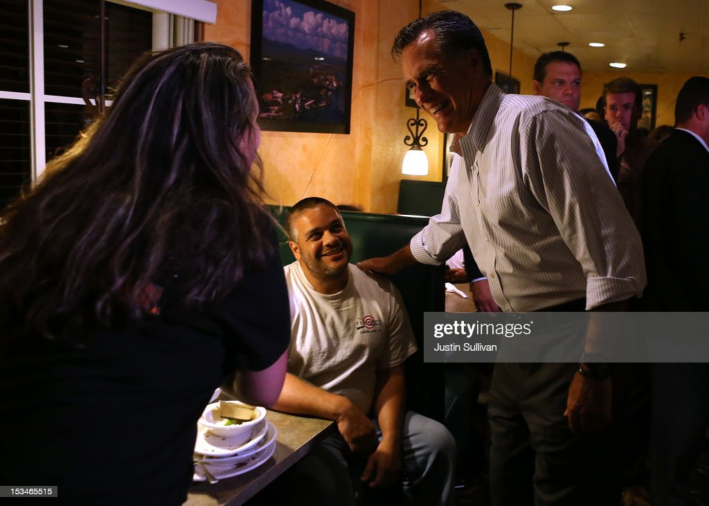 Republican presidential candidate, former Massachusetts Gov. <a gi-track='captionPersonalityLinkClicked' href=/galleries/search?phrase=Mitt+Romney&family=editorial&specificpeople=207106 ng-click='$event.stopPropagation()'>Mitt Romney</a> greets diners at Capedevila's at La Teresita restaurant on October 5, 2012 in Tampa, Florida. <a gi-track='captionPersonalityLinkClicked' href=/galleries/search?phrase=Mitt+Romney&family=editorial&specificpeople=207106 ng-click='$event.stopPropagation()'>Mitt Romney</a> is campaigning in Virginia coal country and in Florida.