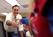 Republican presidential candidate former Massachusetts Gov Mitt Romney greets workers at call center on November 6 2012 in Pittsburgh Pennsylvania...