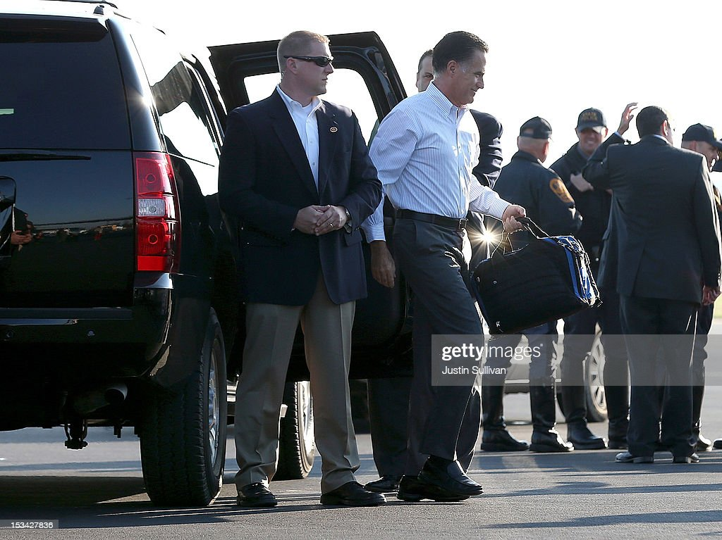 Republican presidential candidate, former Massachusetts Gov. <a gi-track='captionPersonalityLinkClicked' href=/galleries/search?phrase=Mitt+Romney&family=editorial&specificpeople=207106 ng-click='$event.stopPropagation()'>Mitt Romney</a> gets out of his car before boarding his campaign plane on October 5, 2012 in Weyers Cave, Viriginia. <a gi-track='captionPersonalityLinkClicked' href=/galleries/search?phrase=Mitt+Romney&family=editorial&specificpeople=207106 ng-click='$event.stopPropagation()'>Mitt Romney</a> will campaign in Virginia coal country and Florida.
