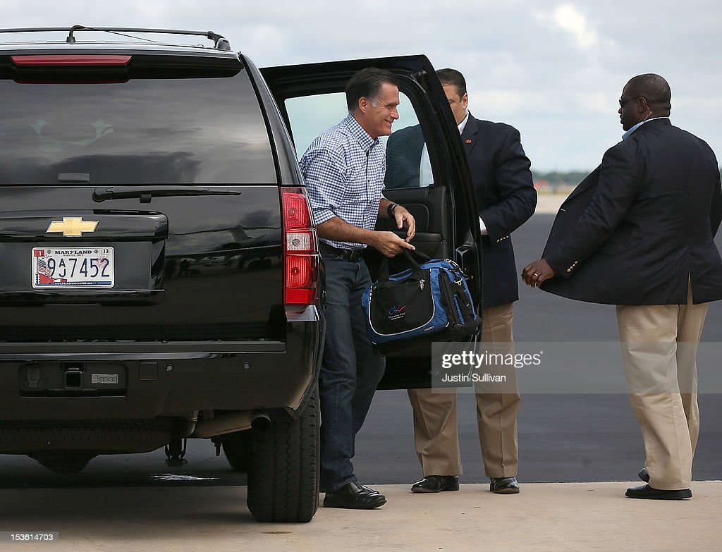 Republican presidential candidate, former Massachusetts Gov. <a gi-track='captionPersonalityLinkClicked' href=/galleries/search?phrase=Mitt+Romney&family=editorial&specificpeople=207106 ng-click='$event.stopPropagation()'>Mitt Romney</a> gets out of his vehicle before boarding his campaign plane on October 7, 2012 in Orlando, Florida. Romney continues his campaign trip in Florida.