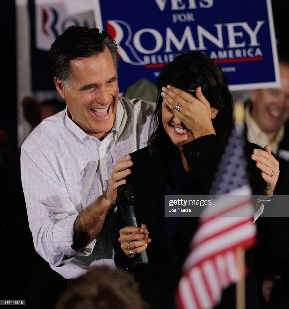 Republican presidential candidate, former Massachusetts Gov. <a gi-track='captionPersonalityLinkClicked' href=/galleries/search?phrase=Mitt+Romney&family=editorial&specificpeople=207106 ng-click='$event.stopPropagation()'>Mitt Romney</a> has a laugh with South Carolina Gov. <a gi-track='captionPersonalityLinkClicked' href=/galleries/search?phrase=Nikki+Haley+-+Guvern%C3%B6r&family=editorial&specificpeople=6974701 ng-click='$event.stopPropagation()'>Nikki Haley</a> after she misspoke during a campaign rally at the Sawmill on January 20, 2012 in Greenville, South Carolina. Romney continues to campaign for votes in South Carolina ahead of the primary on January 21.