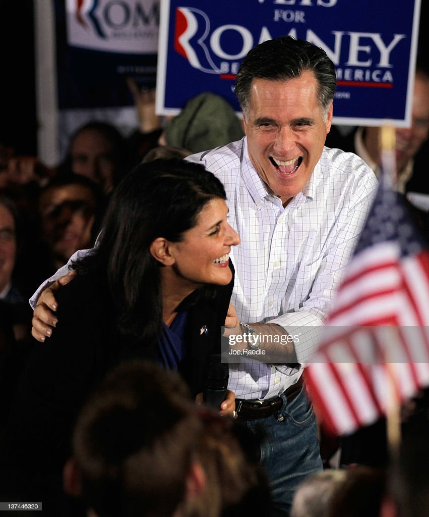 Republican presidential candidate, former Massachusetts Gov. <a gi-track='captionPersonalityLinkClicked' href=/galleries/search?phrase=Mitt+Romney&family=editorial&specificpeople=207106 ng-click='$event.stopPropagation()'>Mitt Romney</a> has a laugh with South Carolina Governor <a gi-track='captionPersonalityLinkClicked' href=/galleries/search?phrase=Nikki+Haley+-+Governor&family=editorial&specificpeople=6974701 ng-click='$event.stopPropagation()'>Nikki Haley</a> after he corrected her after she misspoke during a campaign rally at the Sawmill on January 20, 2012 in Greenville, South Carolina. Romney continues to campaign for votes in South Carolina ahead of the primary on January 21.