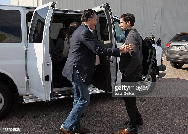 Republican presidential candidate former Massachusetts Gov Mitt Romney embraces his son Matt Romney after arriving at the airport for a campaign...