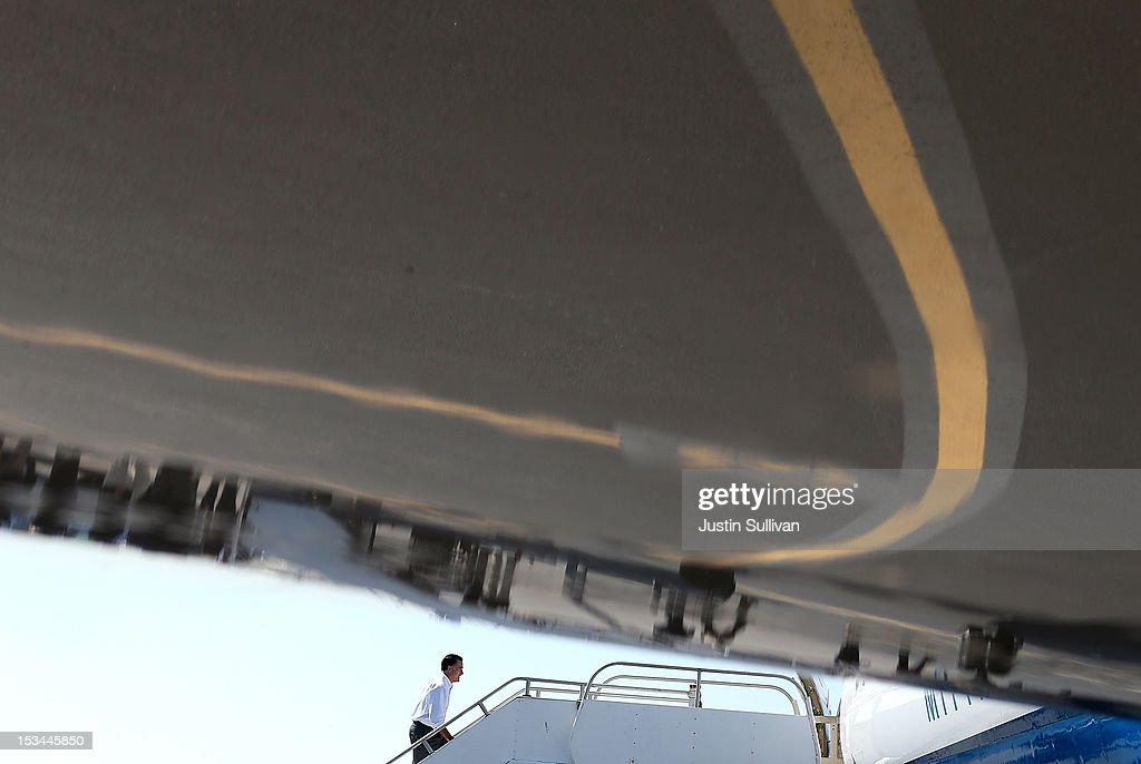 Republican presidential candidate, former Massachusetts Gov. <a gi-track='captionPersonalityLinkClicked' href=/galleries/search?phrase=Mitt+Romney&family=editorial&specificpeople=207106 ng-click='$event.stopPropagation()'>Mitt Romney</a> boards his campaign plane on October 5, 2012 in Bristol, Tennessee. <a gi-track='captionPersonalityLinkClicked' href=/galleries/search?phrase=Mitt+Romney&family=editorial&specificpeople=207106 ng-click='$event.stopPropagation()'>Mitt Romney</a> is campaigning in Virginia coal country and Florida.