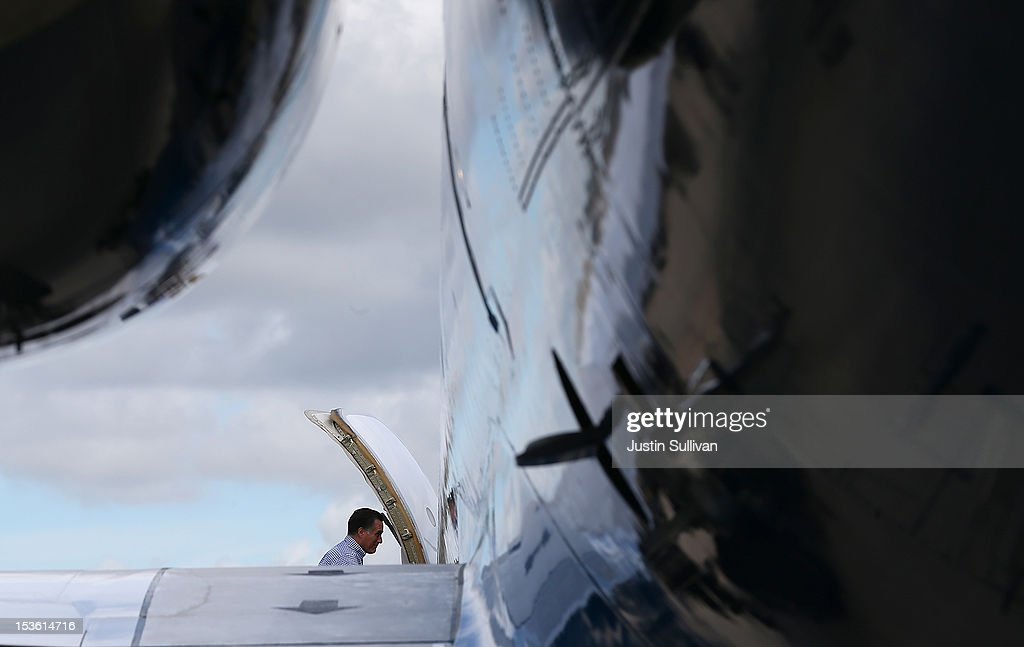 Republican presidential candidate, former Massachusetts Gov. <a gi-track='captionPersonalityLinkClicked' href=/galleries/search?phrase=Mitt+Romney&family=editorial&specificpeople=207106 ng-click='$event.stopPropagation()'>Mitt Romney</a> boards his campaign plane on October 7, 2012 in Orlando, Florida. Romney continues his campaign trip in Florida.