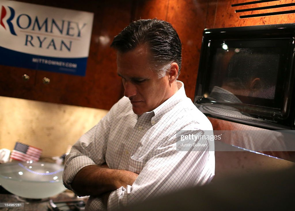 Republican presidential candidate, former Massachusetts Gov. <a gi-track='captionPersonalityLinkClicked' href=/galleries/search?phrase=Mitt+Romney&family=editorial&specificpeople=207106 ng-click='$event.stopPropagation()'>Mitt Romney</a> rides his campaign bus en route to a campaign rally at Avon Lake High School on October 29, 2012 in Avon Lake, Ohio. Romney canceled campaign events on October 29 and 30 due to Hurricane Sandy.