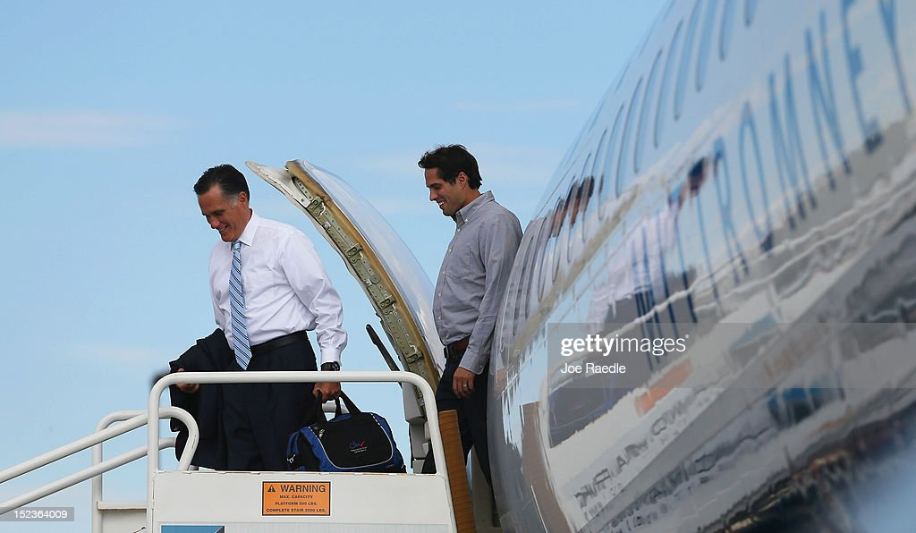 Republican presidential candidate, former Massachusetts Gov. <a gi-track='captionPersonalityLinkClicked' href=/galleries/search?phrase=Mitt+Romney&family=editorial&specificpeople=207106 ng-click='$event.stopPropagation()'>Mitt Romney</a> walks off his plane with his son, <a gi-track='captionPersonalityLinkClicked' href=/galleries/search?phrase=Craig+Romney&family=editorial&specificpeople=4453864 ng-click='$event.stopPropagation()'>Craig Romney</a>, at Landmark Aviation, at the Miami International Airport on September 19, 2012 in Miami, Florida. Romney continues to campaign for votes around the country.