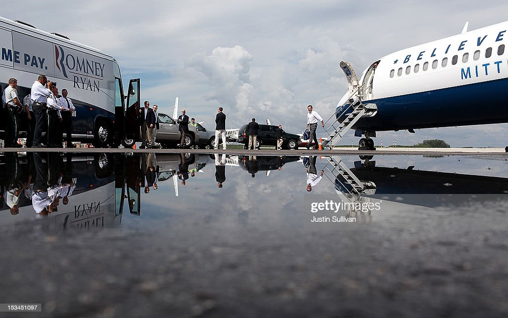 Republican presidential candidate, former Massachusetts Gov. Mitt Romney (R) walks off his campaign plane at St. Petersburg Clearwater International Airporton October 5, 2012 in Clearwater, Florida. Mitt Romney is campaigning in Virginia coal country and Florida.