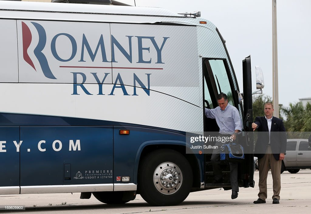 Republican presidential candidate, former Massachusetts Gov. <a gi-track='captionPersonalityLinkClicked' href=/galleries/search?phrase=Mitt+Romney&family=editorial&specificpeople=207106 ng-click='$event.stopPropagation()'>Mitt Romney</a> steps off of his bus before boarding his campaign plane on October 7, 2012 in Palm Beach, Florida. <a gi-track='captionPersonalityLinkClicked' href=/galleries/search?phrase=Mitt+Romney&family=editorial&specificpeople=207106 ng-click='$event.stopPropagation()'>Mitt Romney</a> is campaigning in Florida before traveling to Virginia where he is scheduled to give a foreign policy speech at the Virginia Military Institute.