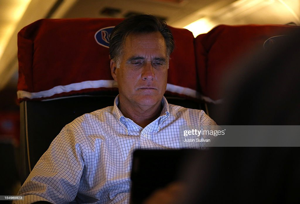 Republican presidential candidate, former Massachusetts Gov. Mitt Romney works on his iPad on October 29, 2012 en route to Dayton, Ohio. Romney has canceled other campaign events on October 29 and 30 due to Hurricane Sandy.