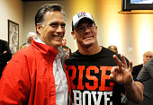 Republican presidential candidate former Massachusetts Gov Mitt Romney poses with professional wrestler John Cena during the driver's meeting prior...
