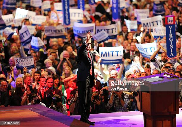 Republican presidential candidate former Massachusetts Gov Mitt Romney waves after accepting the nomination during the final day of the Republican...