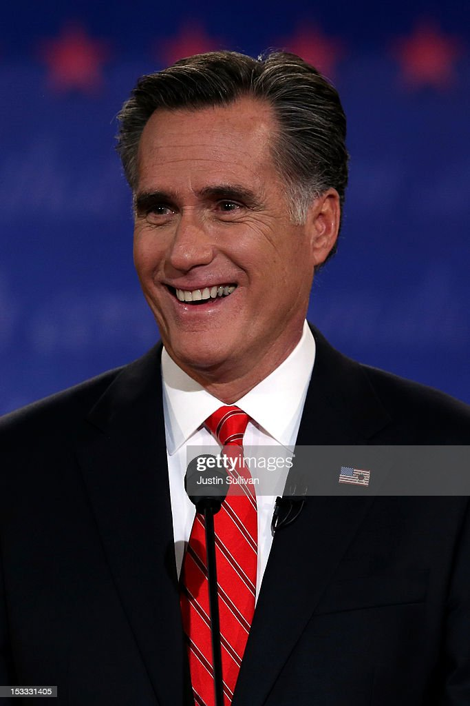 Republican presidential candidate, former Massachusetts Gov. <a gi-track='captionPersonalityLinkClicked' href=/galleries/search?phrase=Mitt+Romney&family=editorial&specificpeople=207106 ng-click='$event.stopPropagation()'>Mitt Romney</a> smiles during the Presidential Debate at the University of Denver on October 3, 2012 in Denver, Colorado. The first of four debates for the 2012 Election, three Presidential and one Vice Presidential, is moderated by PBS's Jim Lehrer and focuses on domestic issues: the economy, health care, and the role of government.