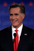 Republican presidential candidate former Massachusetts Gov Mitt Romney smiles during the Presidential Debate at the University of Denver on October 3...
