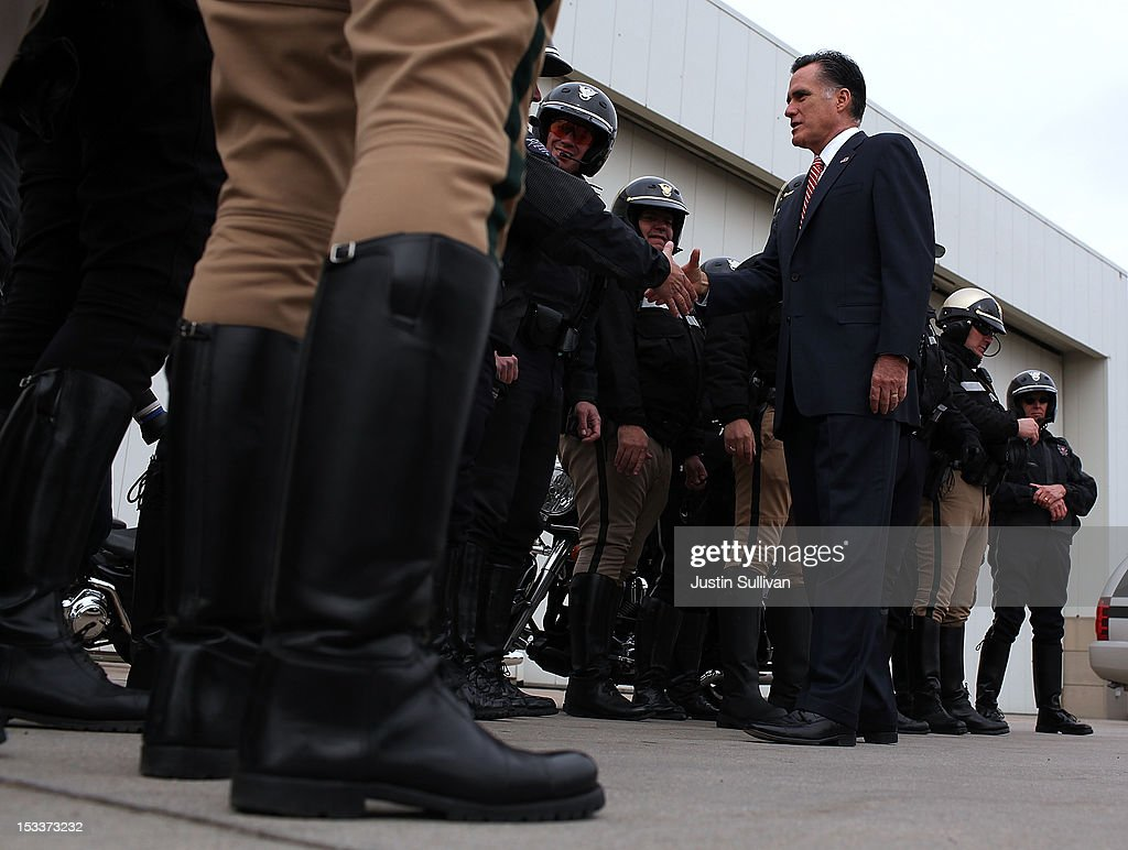 Republican presidential candidate, former Massachusetts Gov. <a gi-track='captionPersonalityLinkClicked' href=/galleries/search?phrase=Mitt+Romney&family=editorial&specificpeople=207106 ng-click='$event.stopPropagation()'>Mitt Romney</a> greets police officers on the tarmac before boarding his campaign plane at Denver International Airport on October 4, 2012 in Denver, Colorado. One day after the first presidential debate, <a gi-track='captionPersonalityLinkClicked' href=/galleries/search?phrase=Mitt+Romney&family=editorial&specificpeople=207106 ng-click='$event.stopPropagation()'>Mitt Romney</a> spoke to the CPAC before heading to Virginia to campaign with his running mate Rep. Paul Ryan (R-WI).