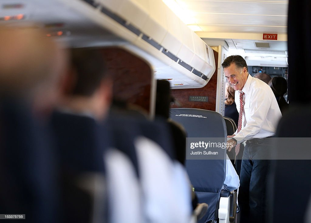 Republican presidential candidate, former Massachusetts Gov. <a gi-track='captionPersonalityLinkClicked' href=/galleries/search?phrase=Mitt+Romney&family=editorial&specificpeople=207106 ng-click='$event.stopPropagation()'>Mitt Romney</a> jokes with members of his staff aboard his campaign plane at Denver International Airport on October 4, 2012 in Denver, Colorado. One day after the first presidential debate, <a gi-track='captionPersonalityLinkClicked' href=/galleries/search?phrase=Mitt+Romney&family=editorial&specificpeople=207106 ng-click='$event.stopPropagation()'>Mitt Romney</a> spoke to the CPAC before heading to Virginia to campaign with his running mate Rep. Paul Ryan (R-WI).