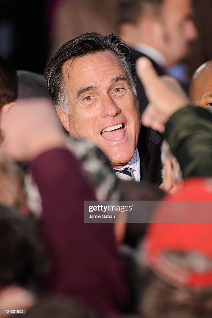 Republican presidential candidate, former Massachusetts Gov. <a gi-track='captionPersonalityLinkClicked' href=/galleries/search?phrase=Mitt+Romney&family=editorial&specificpeople=207106 ng-click='$event.stopPropagation()'>Mitt Romney</a> shakes hands with supporters after a town square rally on October 12, 2012 in Lancaster, Ohio. Romney was campaining a day after running mate U.S. Rep. Paul Ryan (R-WI) debated U.S. Vice President Joe Biden.