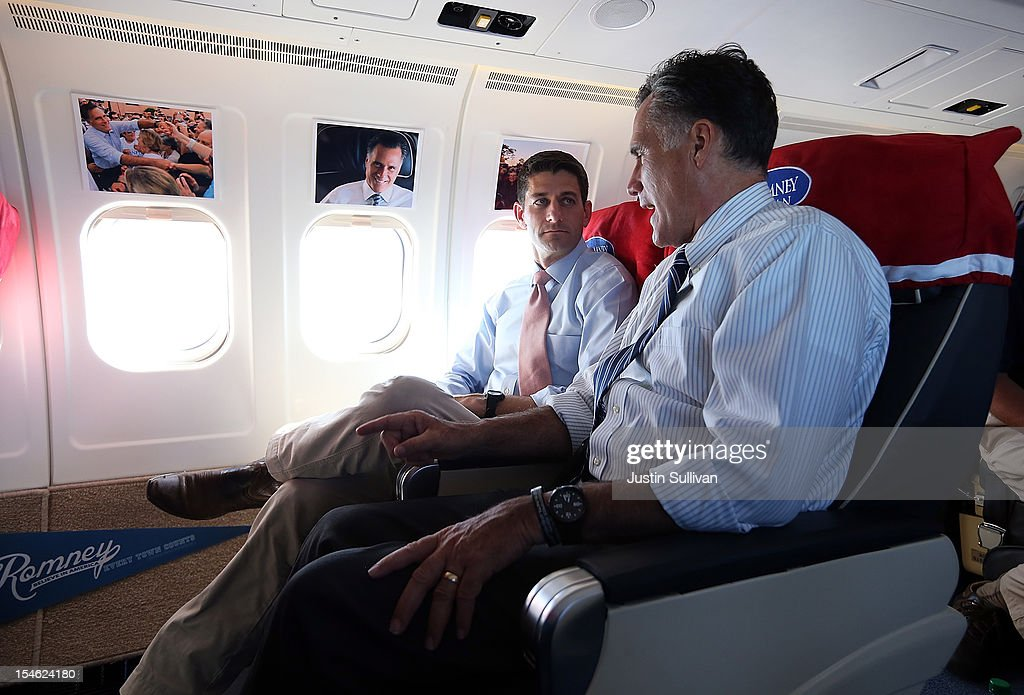 Republican presidential candidate, former Massachusetts Gov. <a gi-track='captionPersonalityLinkClicked' href=/galleries/search?phrase=Mitt+Romney&family=editorial&specificpeople=207106 ng-click='$event.stopPropagation()'>Mitt Romney</a> (R) talks with his running mate Rep. Paul Ryan (R-WI) (L) aboard the campaign plane on October 23, 2012 en route to Denver, Colorado. A day after the final Presidential debate, <a gi-track='captionPersonalityLinkClicked' href=/galleries/search?phrase=Mitt+Romney&family=editorial&specificpeople=207106 ng-click='$event.stopPropagation()'>Mitt Romney</a> is campaigning in Nevada and Colorado.