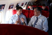 Republican presidential candidate former Massachusetts Gov Mitt Romney talks with his running mate Rep Paul Ryan aboard the campaign plane on October...