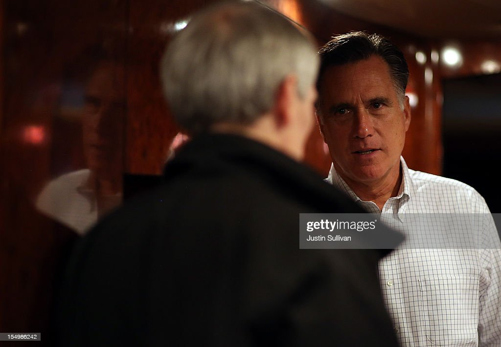 Republican presidential candidate, former Massachusetts Gov. <a gi-track='captionPersonalityLinkClicked' href=/galleries/search?phrase=Mitt+Romney&family=editorial&specificpeople=207106 ng-click='$event.stopPropagation()'>Mitt Romney</a> talks with campaign advisor U.S. Sen. <a gi-track='captionPersonalityLinkClicked' href=/galleries/search?phrase=Rob+Portman&family=editorial&specificpeople=226973 ng-click='$event.stopPropagation()'>Rob Portman</a> (R-OH) on his campaign bus en route to a campaign rally at Avon Lake High School on October 29, 2012 in Avon Lake, Ohio. Romney canceled campaign events on October 29 and 30 due to Hurricane Sandy.
