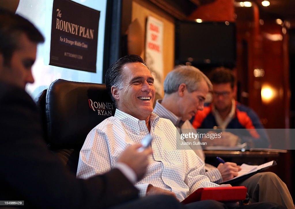 Republican presidential candidate, former Massachusetts Gov. <a gi-track='captionPersonalityLinkClicked' href=/galleries/search?phrase=Mitt+Romney&family=editorial&specificpeople=207106 ng-click='$event.stopPropagation()'>Mitt Romney</a> laughs while riding his campaign bus at a campaign rally at Avon Lake High School on October 29, 2012 in Avon Lake, Ohio. Romney canceled campaign events on October 29 and 30 due to Hurricane Sandy.