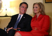Republican presidential candidate former Massachusetts Gov Mitt Romney sits with his wife Ann Romney in a hotel room as they watch television before...
