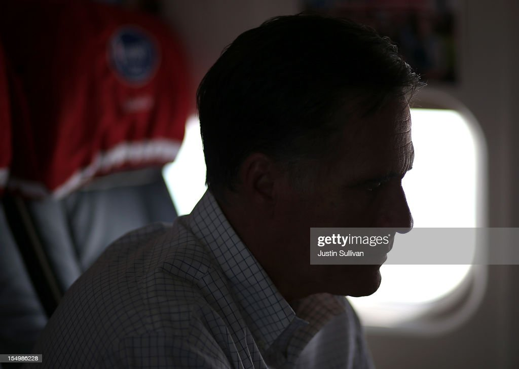Republican presidential candidate, former Massachusetts Gov. Mitt Romney sits on his campaign plane October 29, 2012 en route to Moline, Illinois. Romney canceled campaign events on October 29 and 30 due to Hurricane Sandy.