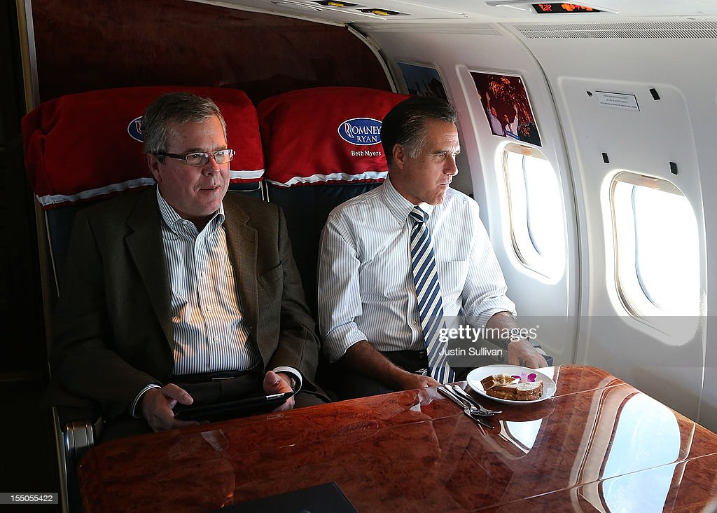 Republican presidential candidate, former Massachusetts Gov. <a gi-track='captionPersonalityLinkClicked' href=/galleries/search?phrase=Mitt+Romney&family=editorial&specificpeople=207106 ng-click='$event.stopPropagation()'>Mitt Romney</a> (R) sits with former Florida Gov. <a gi-track='captionPersonalityLinkClicked' href=/galleries/search?phrase=Jeb+Bush&family=editorial&specificpeople=171487 ng-click='$event.stopPropagation()'>Jeb Bush</a> aboard his campaign plane on October 31, 2012 en route to Miami, Florida. With less than one week to go until election day, <a gi-track='captionPersonalityLinkClicked' href=/galleries/search?phrase=Mitt+Romney&family=editorial&specificpeople=207106 ng-click='$event.stopPropagation()'>Mitt Romney</a> is campaigning throughout Florida.