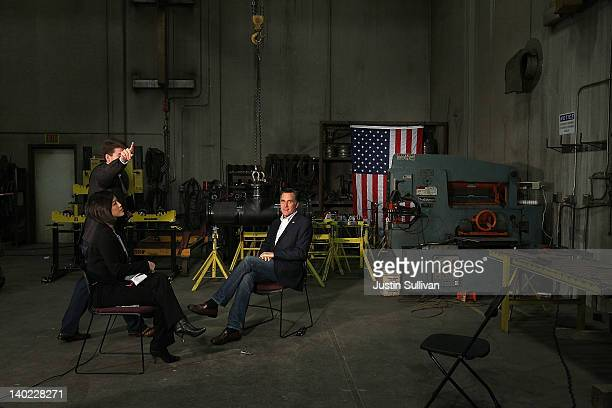 Republican presidential candidate former Massachusetts Gov Mitt Romney prepares to do a television interview following a campaign rally at Wrigley...