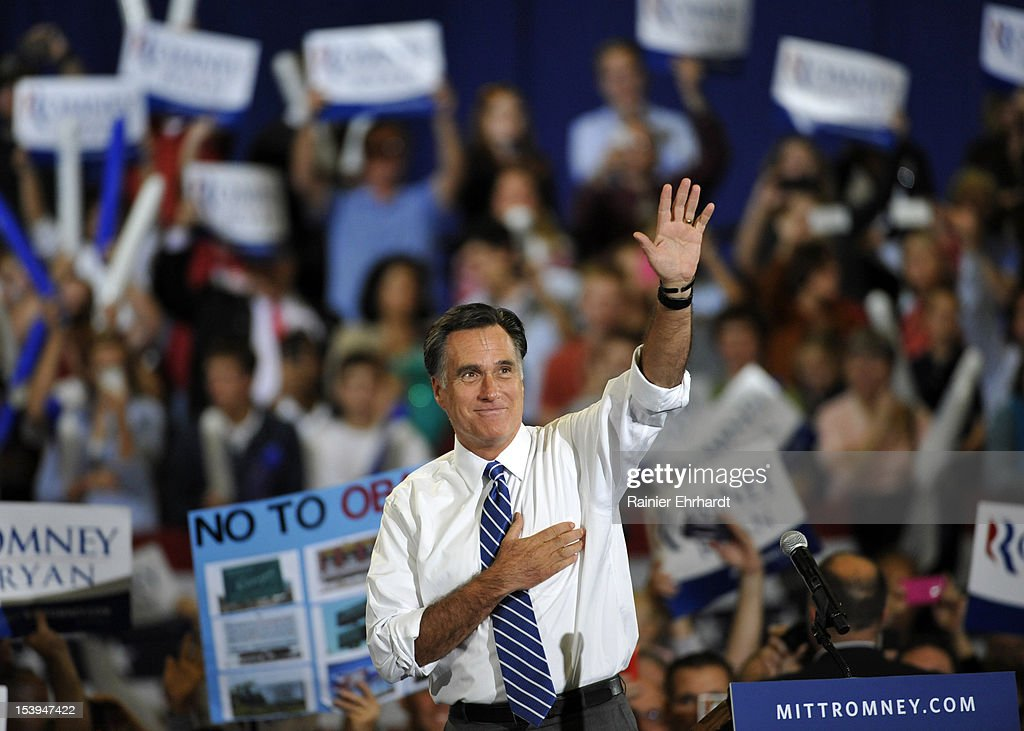 Republican presidential candidate, former Massachusetts Gov. <a gi-track='captionPersonalityLinkClicked' href=/galleries/search?phrase=Mitt+Romney&family=editorial&specificpeople=207106 ng-click='$event.stopPropagation()'>Mitt Romney</a> waves to supporters during a campaign rally on October 11, 2012 in Asheville, North Carolina. Romney is campaigning in North Carolina with less than a month to go before the general election.