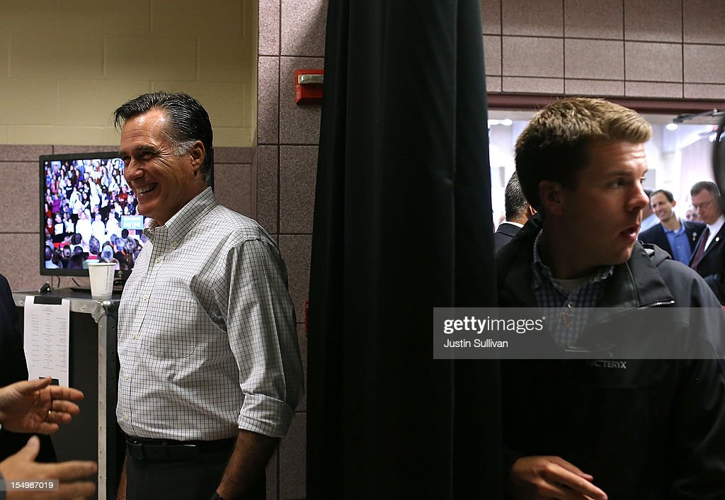 Republican presidential candidate, former Massachusetts Gov. <a gi-track='captionPersonalityLinkClicked' href=/galleries/search?phrase=Mitt+Romney&family=editorial&specificpeople=207106 ng-click='$event.stopPropagation()'>Mitt Romney</a> (L) prepares to take the stage as his personal aide Garrett Jackson (R) looks on before a campaign rally at Avon Lake High School on October 29, 2012 in Avon Lake, Ohio. Romney has canceled other campaign events on October 29 and 30 due to Hurricane Sandy.