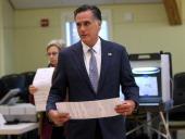 Republican presidential candidate former Massachusetts Gov Mitt Romney prepares to cast his ballot at Beech Street Center on November 6 2012 in...