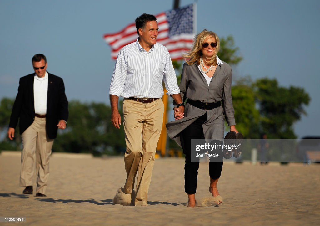 Republican Presidential candidate, former Massachusetts Governor <a gi-track='captionPersonalityLinkClicked' href=/galleries/search?phrase=Mitt+Romney&family=editorial&specificpeople=207106 ng-click='$event.stopPropagation()'>Mitt Romney</a> and his wife, <a gi-track='captionPersonalityLinkClicked' href=/galleries/search?phrase=Ann+Romney&family=editorial&specificpeople=868004 ng-click='$event.stopPropagation()'>Ann Romney</a>, walk on the beach after the last campaign rally as they complete their five day bus trip in Holland State Park June 19, 2012 in Holland, Michigan. Mr. Romney continues his battle against President Barack Obama for votes.