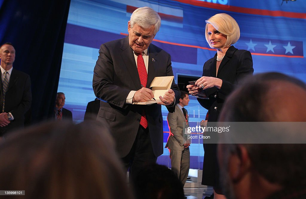 Republican presidential candidate former Speaker of the House Newt Gingrich greets with his wife Callista greets people following the Fox News Channel debate at the Sioux City Convention Center on December 15, 2011 in Sioux City, Iowa. The GOP contenders are in the final stretch of campaigning in Iowa where the January 3rd caucus is the first test the candidates must face before becoming the Republican presidential nominee.