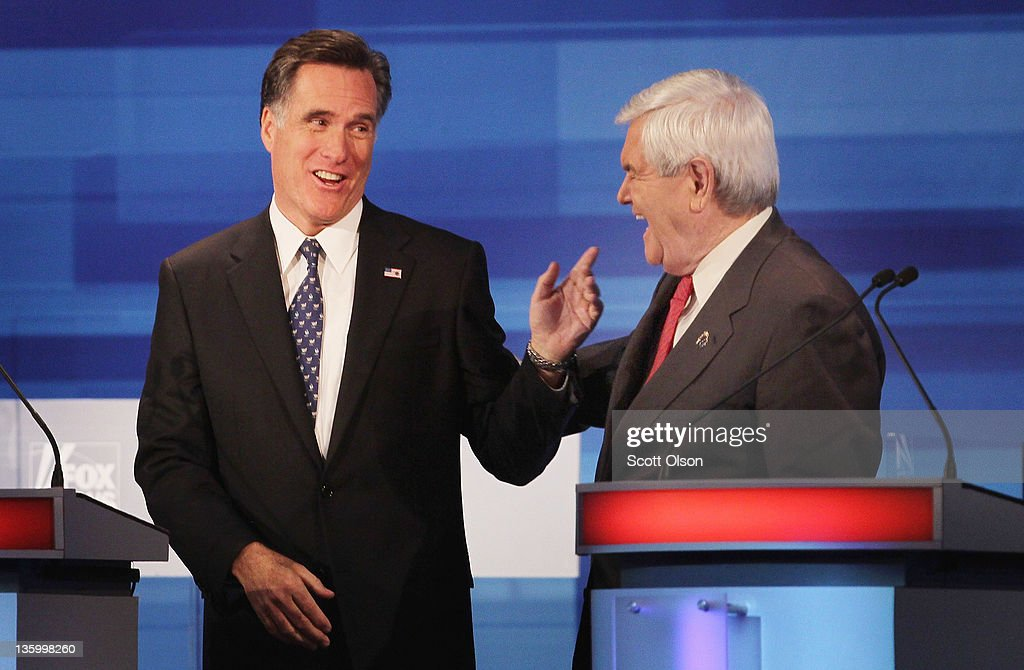 Republican presidential candidate former Speaker of the House <a gi-track='captionPersonalityLinkClicked' href=/galleries/search?phrase=Newt+Gingrich&family=editorial&specificpeople=202915 ng-click='$event.stopPropagation()'>Newt Gingrich</a> (R) and former Massachusetts Gov. <a gi-track='captionPersonalityLinkClicked' href=/galleries/search?phrase=Mitt+Romney&family=editorial&specificpeople=207106 ng-click='$event.stopPropagation()'>Mitt Romney</a> chat after finishing the Fox News Channel debate at the Sioux City Convention Center on December 15, 2011 in Sioux City, Iowa. The GOP contenders are in the final stretch of campaigning in Iowa where the January 3rd caucus is the first test the candidates must face before becoming the Republican presidential nominee.
