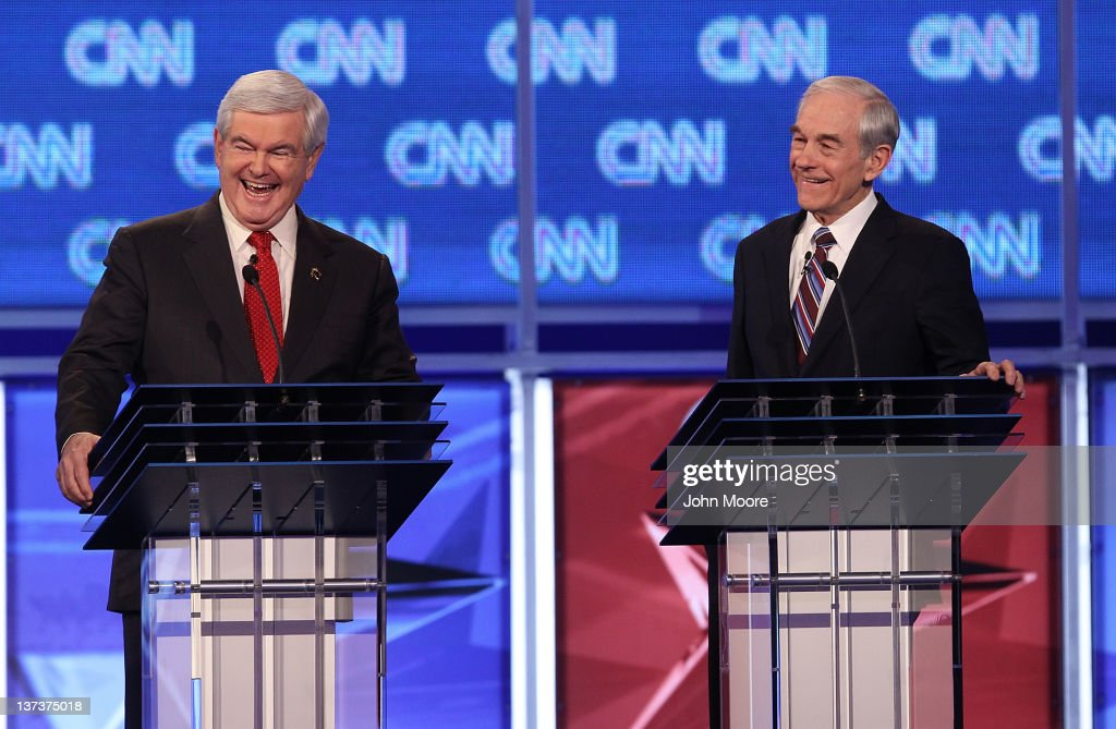 Republican presidential candidate former Speaker of the House <a gi-track='captionPersonalityLinkClicked' href=/galleries/search?phrase=Newt+Gingrich&family=editorial&specificpeople=202915 ng-click='$event.stopPropagation()'>Newt Gingrich</a> (L) laughs after U.S. Rep. <a gi-track='captionPersonalityLinkClicked' href=/galleries/search?phrase=Ron+Paul&family=editorial&specificpeople=2300665 ng-click='$event.stopPropagation()'>Ron Paul</a> (R-TX) made a point during a debate at the North Charleston Coliseum January 19, 2012 in Charleston, South Carolina. The debate, hosted by CNN and the Southern Republican Leadership Conference, is the final debate before South Carolina voters head to the polls for their primary January 21.