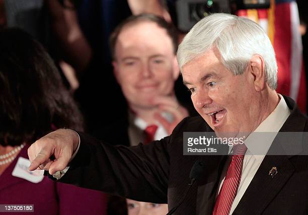 Republican presidential candidate former Speaker of the House Newt Gingrich celebrates as he arrives for a primary night rally January 21 2012 in...