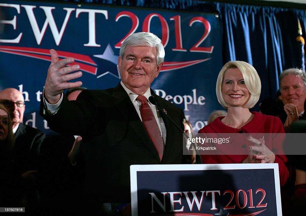 Republican presidential candidate, former Speaker of the House <a gi-track='captionPersonalityLinkClicked' href=/galleries/search?phrase=Newt+Gingrich&family=editorial&specificpeople=202915 ng-click='$event.stopPropagation()'>Newt Gingrich</a> (L) speaks during a primary night rally with his wife <a gi-track='captionPersonalityLinkClicked' href=/galleries/search?phrase=Callista+Gingrich&family=editorial&specificpeople=4374496 ng-click='$event.stopPropagation()'>Callista Gingrich</a> January 21, 2012 in Columbia, South Carolina. With Gingrich finishing first in South Carolina's primary, a different candidate has emerged victorious in the first three contests for the Republican nomination.