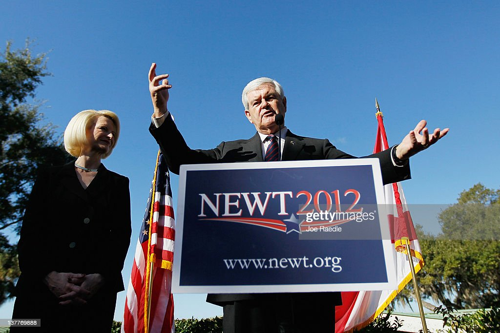 Republican presidential candidate, former Speaker of the House <a gi-track='captionPersonalityLinkClicked' href=/galleries/search?phrase=Newt+Gingrich&family=editorial&specificpeople=202915 ng-click='$event.stopPropagation()'>Newt Gingrich</a> stands with his wife, <a gi-track='captionPersonalityLinkClicked' href=/galleries/search?phrase=Callista+Gingrich&family=editorial&specificpeople=4374496 ng-click='$event.stopPropagation()'>Callista Gingrich</a>, as he speaks during a Lakeside Inn Tea Party Rally on January 26, 2012 in Mount Dora, Florida. Gingrich is campaigning for votes in Florida prior to the state's January 31st primary.