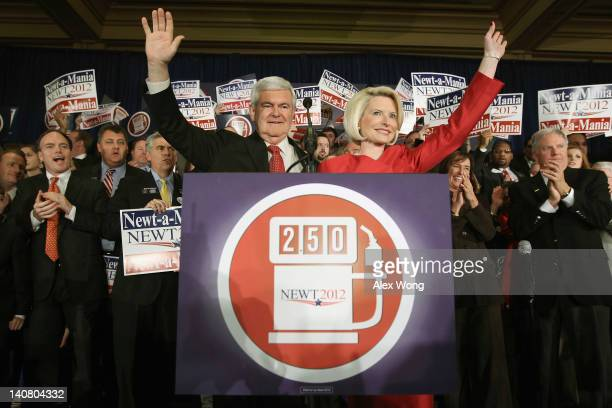 Republican presidential candidate former Speaker of the House Newt Gingrich and his wife Callista Gingrich wave after being declared the winner of...