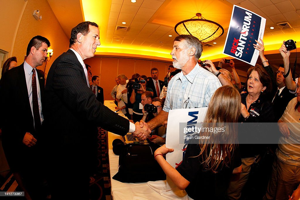 Republican presidential candidate, former U.S. Sen. <a gi-track='captionPersonalityLinkClicked' href=/galleries/search?phrase=Rick+Santorum&family=editorial&specificpeople=212911 ng-click='$event.stopPropagation()'>Rick Santorum</a> greats supporters after winning the both Alabama and Mississippi primaries on March 13, 2012 in Lafayette, Louisiana. Louisiana's primary will be decided on March 24th.
