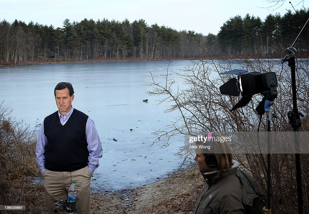 Republican presidential candidate former US Sen Rick Santorum waits for the beginning of a TV interview after he spoke to voters outside Homestead...