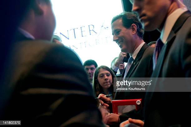 Republican presidential candidate former US Sen Rick Santorum while holding an Etch A Sketch greets supporters during a campaign stop at the...