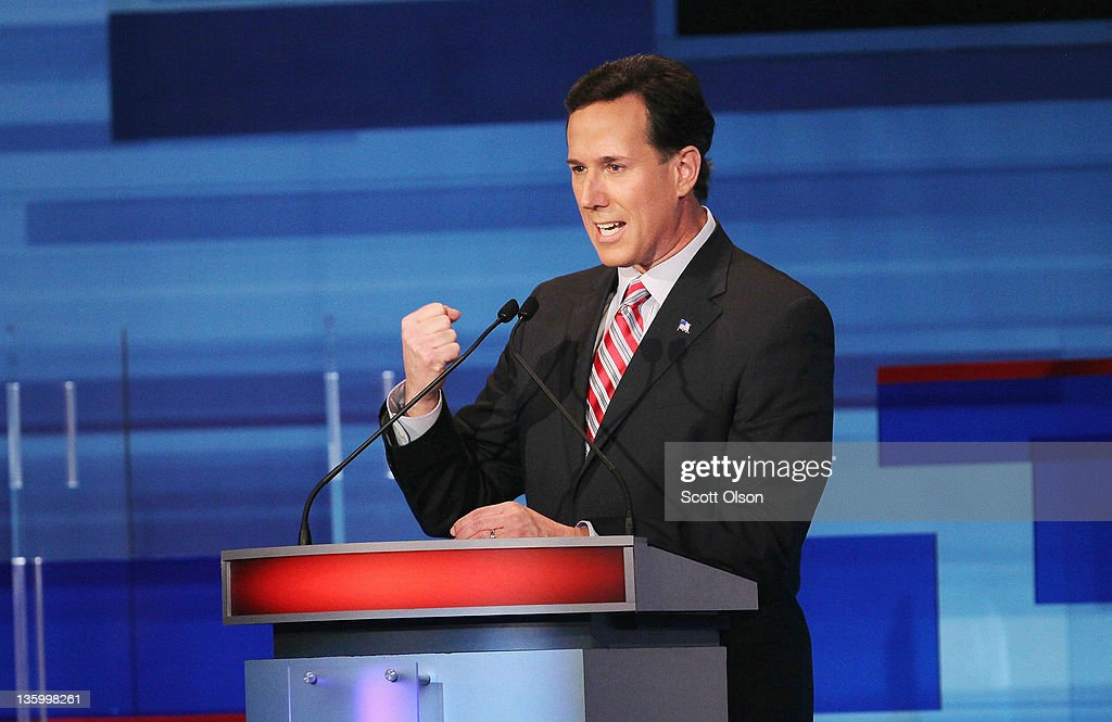 Republican presidential candidate former U.S. Senator <a gi-track='captionPersonalityLinkClicked' href=/galleries/search?phrase=Rick+Santorum&family=editorial&specificpeople=212911 ng-click='$event.stopPropagation()'>Rick Santorum</a> (R-PA) fields a question during the Fox News Channel debate at the Sioux City Convention Center on December 15, 2011 in Sioux City, Iowa. The GOP contenders are in the final stretch of campaigning in Iowa where the January 3rd caucus is the first test the candidates must face before becoming the Republican presidential nominee.