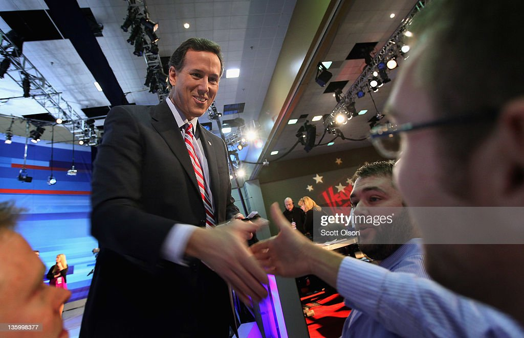 Republican presidential candidate former U.S. Senator <a gi-track='captionPersonalityLinkClicked' href=/galleries/search?phrase=Rick+Santorum&family=editorial&specificpeople=212911 ng-click='$event.stopPropagation()'>Rick Santorum</a> (R-PA) greets people following the Fox News Channel debate at the Sioux City Convention Center on December 15, 2011 in Sioux City, Iowa. The GOP contenders are in the final stretch of campaigning in Iowa where the January 3rd caucus is the first test the candidates must face before becoming the Republican presidential nominee.