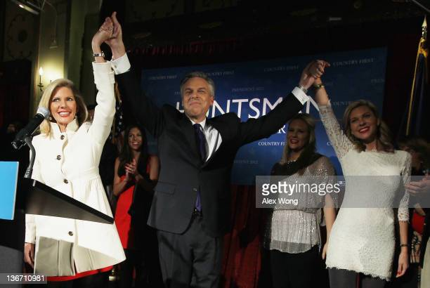Republican presidential candidate former Utah Gov Jon Huntsman celebrates his wife Mary Kaye Huntsman and daughters Abby Liddy and Mary Anne at his...